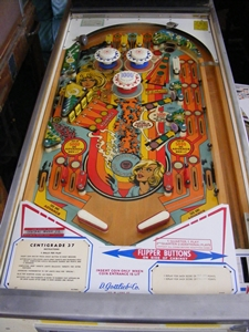 black rings on an EM pinball playfield